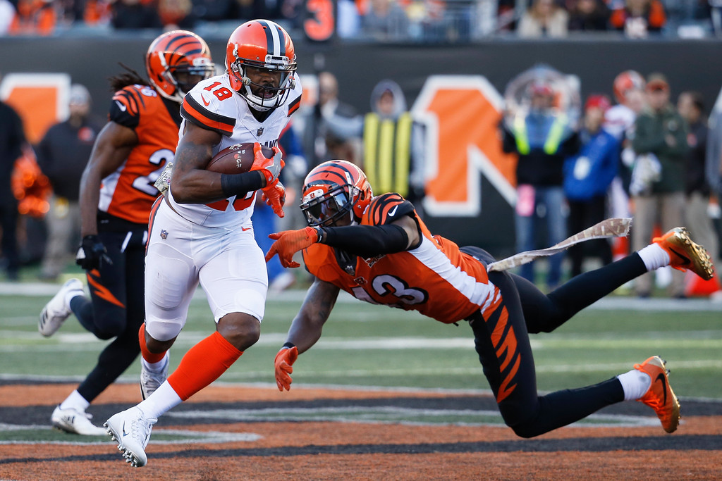 . Cleveland Browns wide receiver Kenny Britt (18) shakes off Cincinnati Bengals free safety George Iloka (43) in the second half of an NFL football game, Sunday, Nov. 26, 2017, in Cincinnati. (AP Photo/Frank Victores)