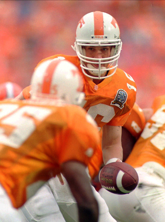 . Tennessee quarterback Peyton Manning hands off to running back Jay Graham (25) during his team\'s 35-29 loss to Florida on Saturday, Sept. 21, 1996, in Knoxville, Tenn. Manning threw for 492 and four touchdowns in the loss. (AP Photo/Wade Payne)