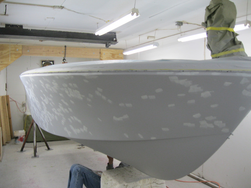 Primer being spot puttied and sanded ready for color.