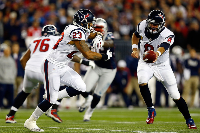 . Matt Schaub #8 of the Houston Texans hands the ball off to Arian Foster #23 during the 2013 AFC Divisional Playoffs game at Gillette Stadium on January 13, 2013 in Foxboro, Massachusetts.  (Photo by Jared Wickerham/Getty Images)