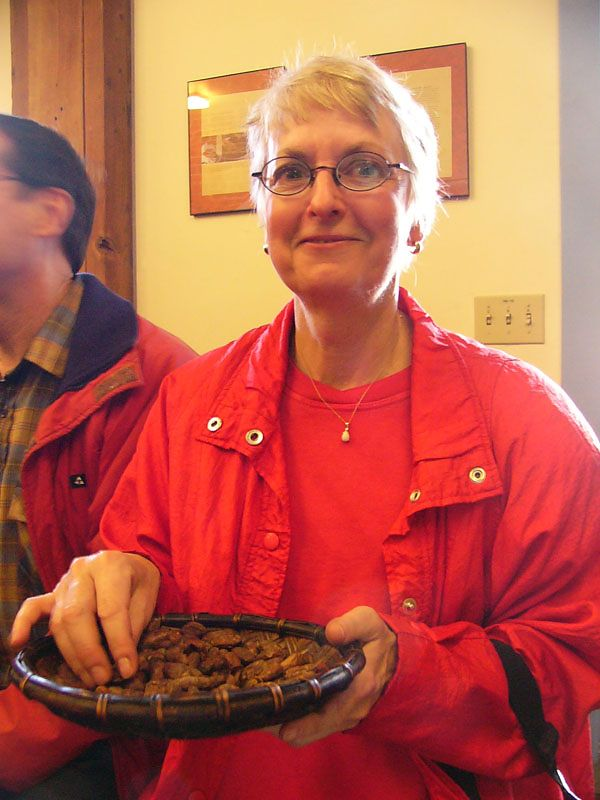 Susan Belmont samples some of the roasted beans