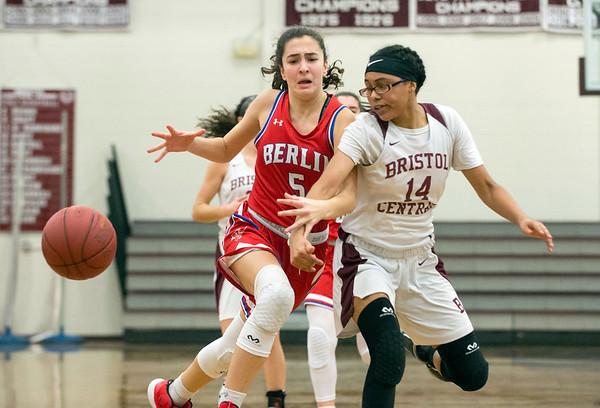 01/10/20 Wesley Bunnell | StaffrrThe Bristol Central girls basketball team was defeated at home on Friday night by Berlin. Berlin's Alivia Halkias (5) has the ball knocked away by BC's Janessa Bartell (14).
