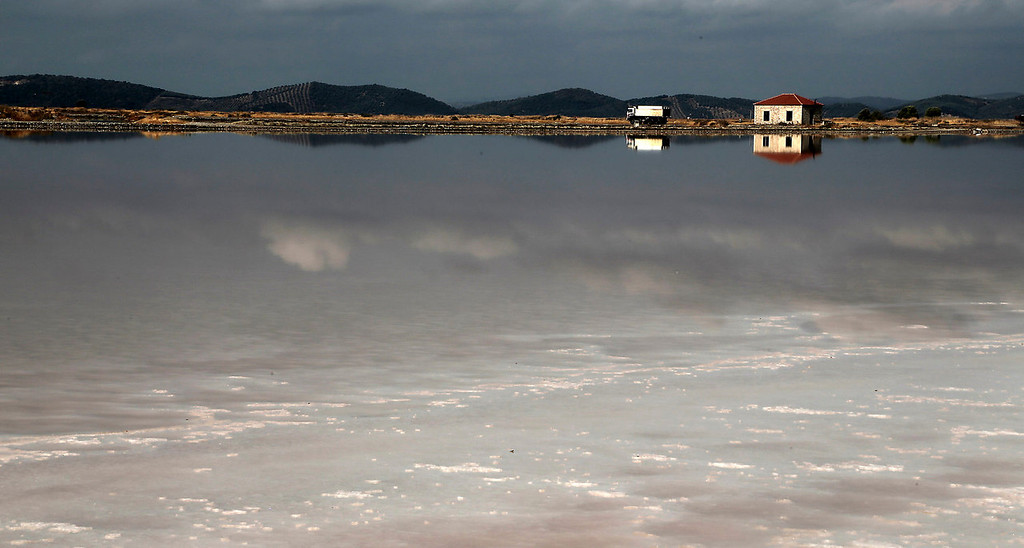 . A truck transports salt along the saltworks at a production site in Messolongi, western Greece. The facilities at the site are the largest saltworks in Greece, and are located at a protected wetland complex of estuaries and lagoons. (AP Photo/Dimitri Messinis)