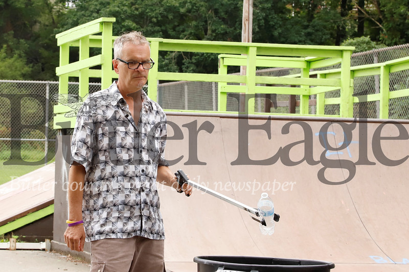 Tony Frochio picks up trash at Father Marinaro Park. Seb Foltz/Butler Eagle