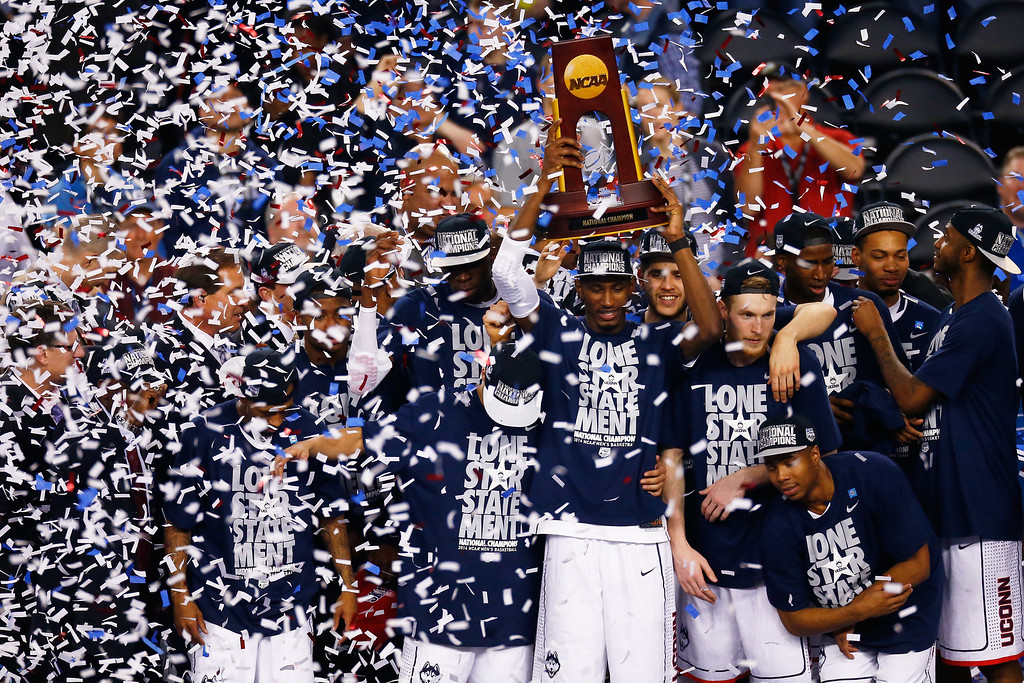. ARLINGTON, TX - APRIL 07: DeAndre Daniels #2 of the Connecticut Huskies holds up the trophy after defeating the Kentucky Wildcats 60-54 in the NCAA Men\'s Final Four Championship at AT&T Stadium on April 7, 2014 in Arlington, Texas.  (Photo by Tom Pennington/Getty Images)