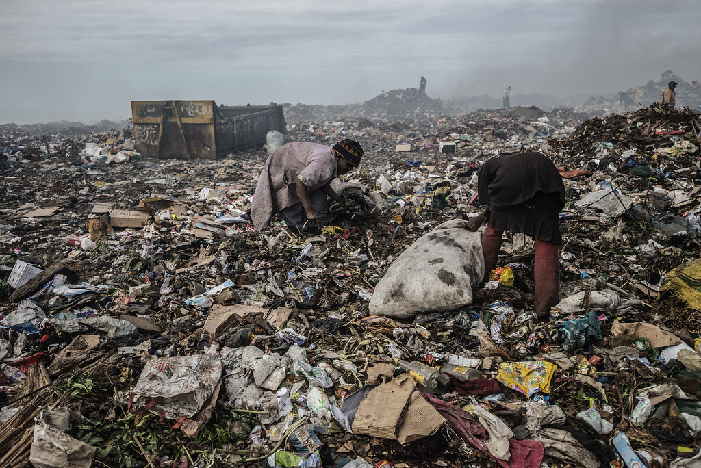. Rubbish pickers sift through garbage at the Maputo municipal garbage dumping site in Maputo on October 14, 2014. GIANLUIGI GUERCIA/AFP/Getty Images