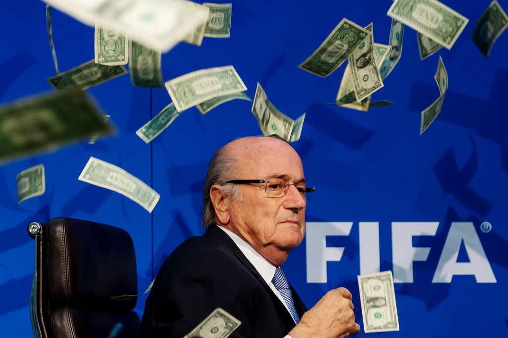 . Comedian Simon Brodkin (not pictured) throws dollar bills at FIFA President Joseph S. Blatter during a press conference at the Extraordinary FIFA Executive Committee Meeting at the FIFA headquarters on July 20, 2015 in Zurich, Switzerland. (Photo by Philipp Schmidli/Getty Images)