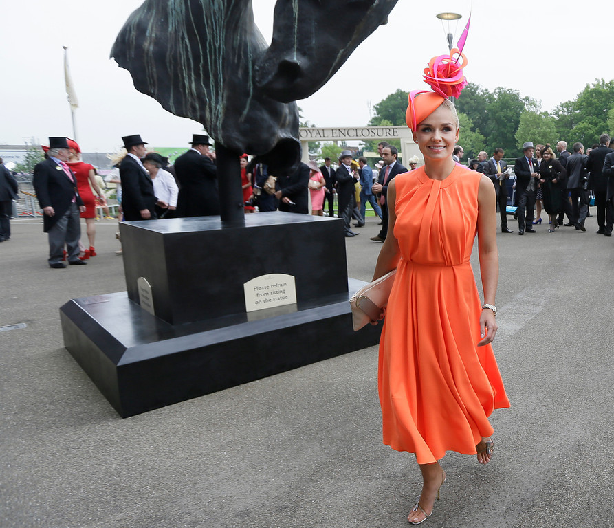. Singer Katherine Jenkins arrives and poses for the media on the first day of the Royal Ascot horse race meeting in Ascot, England, Tuesday, June 18, 2013. (AP Photo/Alastair Grant)