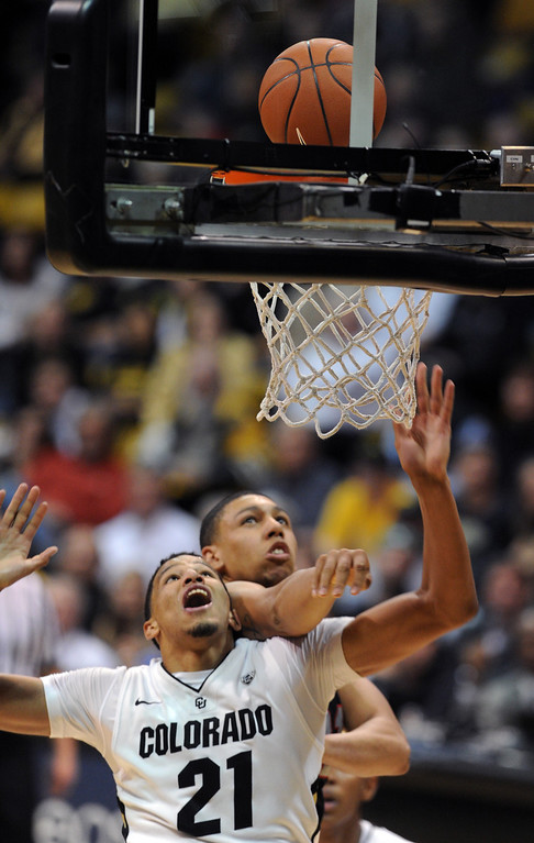 . Andre Roberson gets rebound position of Cedric Martin of Utah during the second half of the February 21st, 2013 game in Boulder. For more photos of the game, go to www.dailycamera.com. Cliff Grassmick / February 21, 2013