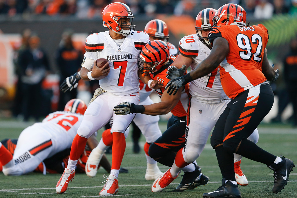 . Cleveland Browns quarterback DeShone Kizer (7) is sacked by Cincinnati Bengals defensive end Jordan Willis (75) in the second half of an NFL football game, Sunday, Nov. 26, 2017, in Cincinnati. (AP Photo/Gary Landers)