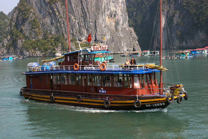 Many tourist boats float on Halong Bay, Vietnam and the fishing village there.