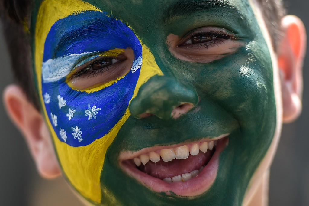 . A fan of Brazil cheers outside Mineirao stadium, in Belo Horizonte, Brazil, a few hours before the start of the FIFA World Cup semi-final match between Brazil and Germany, on July 8, 2014.  AFP PHOTO / GUSTAVO ANDRADE/AFP/Getty Images