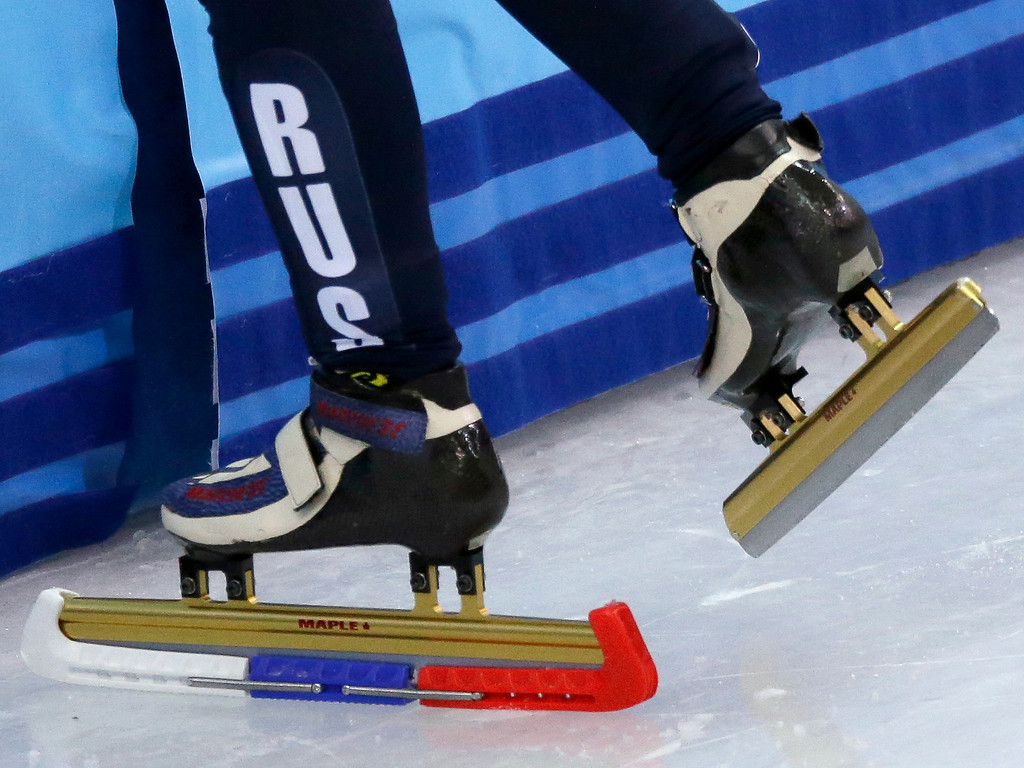 . Tatiana Borodulina, of Russia, leaves the track after a second false start during a heat in the women\'s 500m short track speedskating competition the 2014 Winter Olympics, Monday, Feb. 10, 2014, in Sochi, Russia. (AP Photo/David J. Phillip )