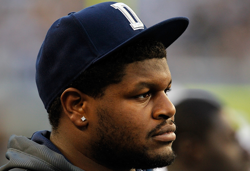 Description of . Dallas Cowboys player, Josh Brent, stands on the sidelines as the Dallas Cowboys take on the Pittsburgh Steelers at Cowboys Stadium on December 16, 2012 in Arlington, Texas. Brent is facing intoxication manslaughter charges after a one-car automobile accident that resulted in the death of teammate Jerry Brown.  (Photo by Tom Pennington/Getty Images)