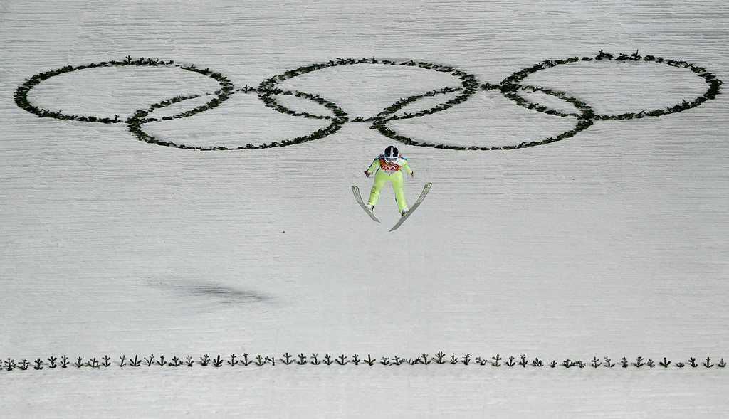 . Slovenia\'s Maja Vtic makes her first attempt during the women\'s normal hill ski jumping final at the 2014 Winter Olympics, Tuesday, Feb. 11, 2014, in Krasnaya Polyana, Russia. (AP Photo/Matthias Schrader)