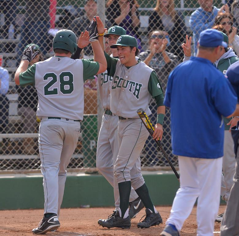 . 0509_SPT_TDB-L-SOUTH-ELSEG--- El Segundo, CALIFORNIA--5/8/13--- Staff Photo: Robert Casillas / LANG--- South Torrance defeated host El Segundo 6-3 in Pioneer League baseball game. Konnor Provin celebrates second homer.