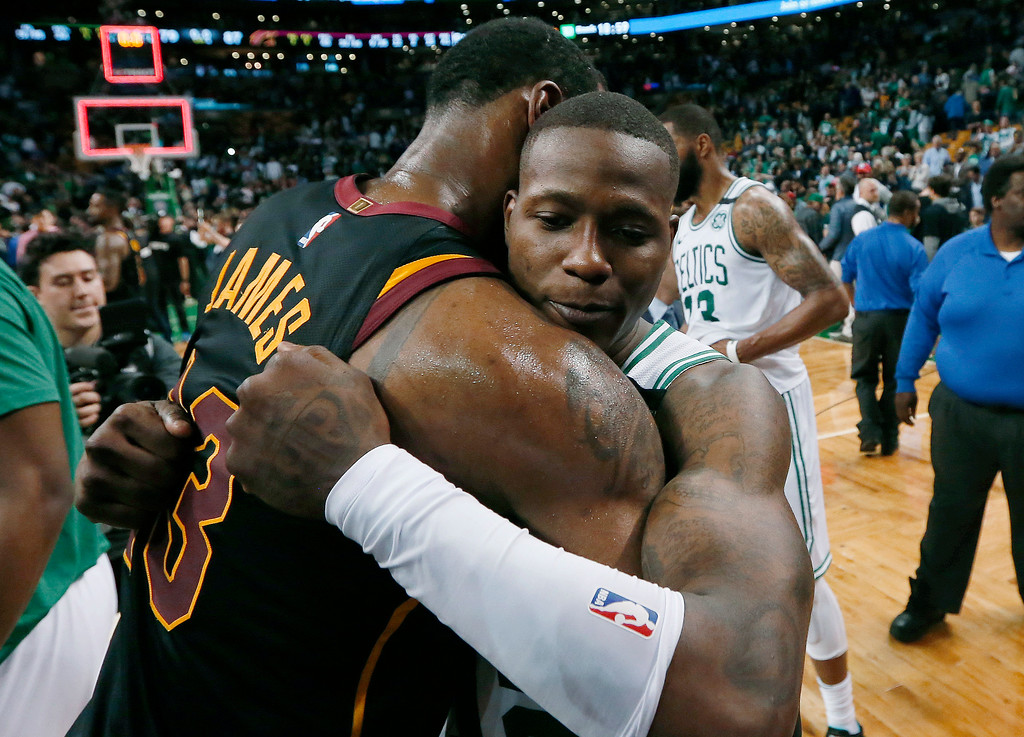 . Cleveland Cavaliers forward LeBron James, left, embraces Boston Celtics guard Terry Rozier after the Cavaliers\' 87-79 victory in Game 7 of the NBA basketball Eastern Conference finals, Sunday, May 27, 2018, in Boston. (AP Photo/Elise Amendola)