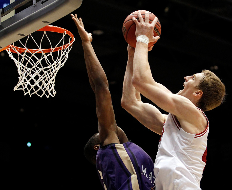 . Indiana Hoosiers forward Cody Zeller (R) shoots over James Madison Dukes guard Alioune Diouf (5) during the first half of their second round NCAA tournament basketball game in Dayton, Ohio March 22, 2013. REUTERS/Matt Sullivan