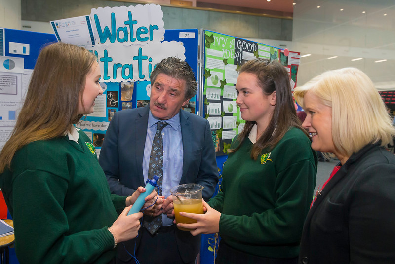 "01/05/2018. SciFest at WIT (Waterford Institute of Technology) at the Arena. Pictured are Belinda Nolan and Peig Delaney from St. Marys School, New Ross with their project on ""Water Filtration"" with Minister John Halligan TD and Dr. Sheila Donegan Calmast WIT. Picture: Patrick Browne"