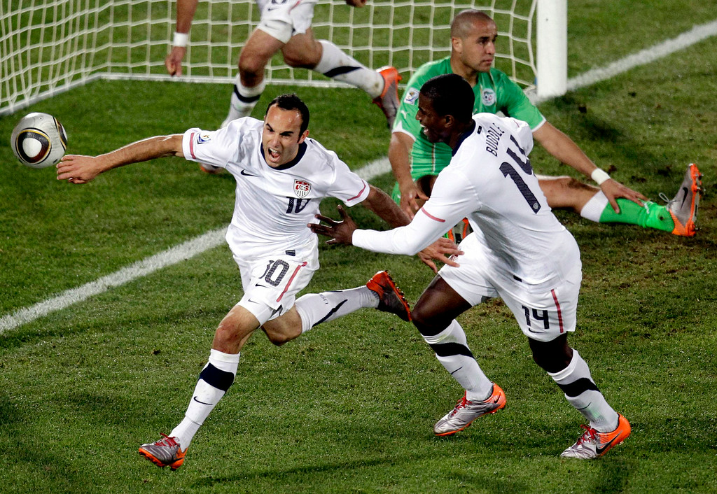 . United States\' Landon Donovan, front left, celebrates after scoring a goal with fellow team members United States\' Clint Dempsey, back left, and United States\' Edson Buddle, front right, during the World Cup group C soccer match between the United States and Algeria at the Loftus Versfeld Stadium in Pretoria, South Africa, Wednesday, June 23, 2010.  (AP Photo/Michael Sohn)