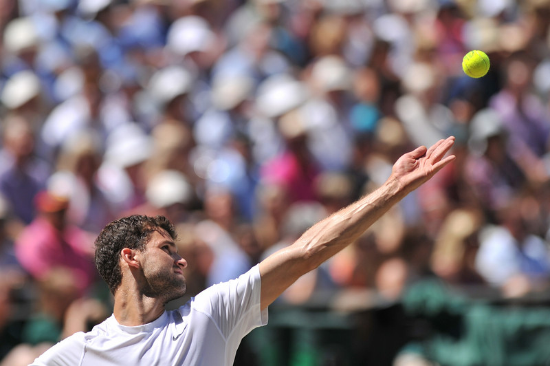 . Bulgaria\'s Grigor Dimitrov serves to Serbia\'s Novak Djokovic during their men\'s singles semi-final match on day 11 of  the 2014 Wimbledon Championships at The All England Tennis Club in Wimbledon, southwest London, on July 4, 2014. (GLYN KIRK/AFP/Getty Images)