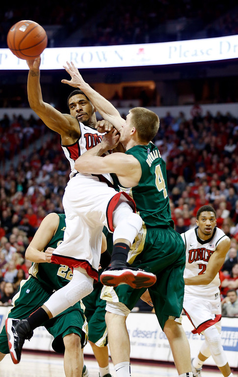 . UNLV\'s Anthony Marshall passes covered by Colorado State\'s Jonathan Octeus during the second half of an NCAA college basketball game on Wednesday, Feb. 20, 2013, in Las Vegas. UNLV defeated Colorado State 61-59. (AP Photo/Isaac Brekken)