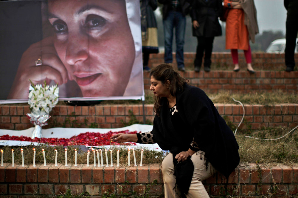 Description of . A Supporter of Pakistan's slain leader Benazir Bhutto lights a candle during a ceremony to mark the fifth anniversary of her death, in Islamabad, Pakistan, Thursday, Dec. 27, 2012. The 24-year-old son of former Pakistani Prime Minister Benazir Bhutto has launched his political career with a fiery speech on the fifth anniversary of his mother's assassination. (AP Photo/Muhammed Muheisen)