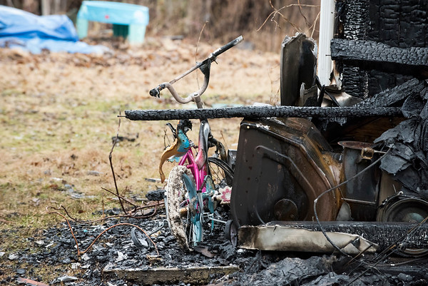 02/10/20 Wesley Bunnell | Staffrr960 East Johnson Ave. in Southington where an overnight fire occurred into the early hours of Monday morning. A children's bicycle is visible on the front corner of the house.