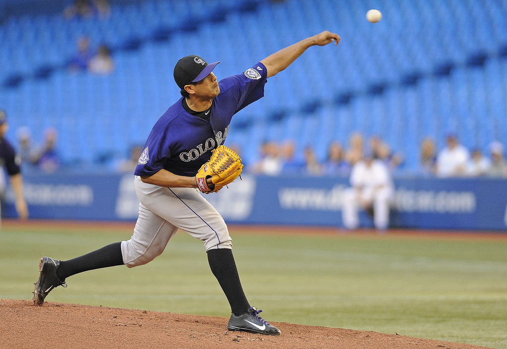 . Jorge De La Rosa #29 of the Colorado Rockies delivers a pitch during inter-league MLB game action against the Toronto Blue Jays June 17, 2013 at Rogers Centre in Toronto, Ontario, Canada. (Photo by Brad White/Getty Images)