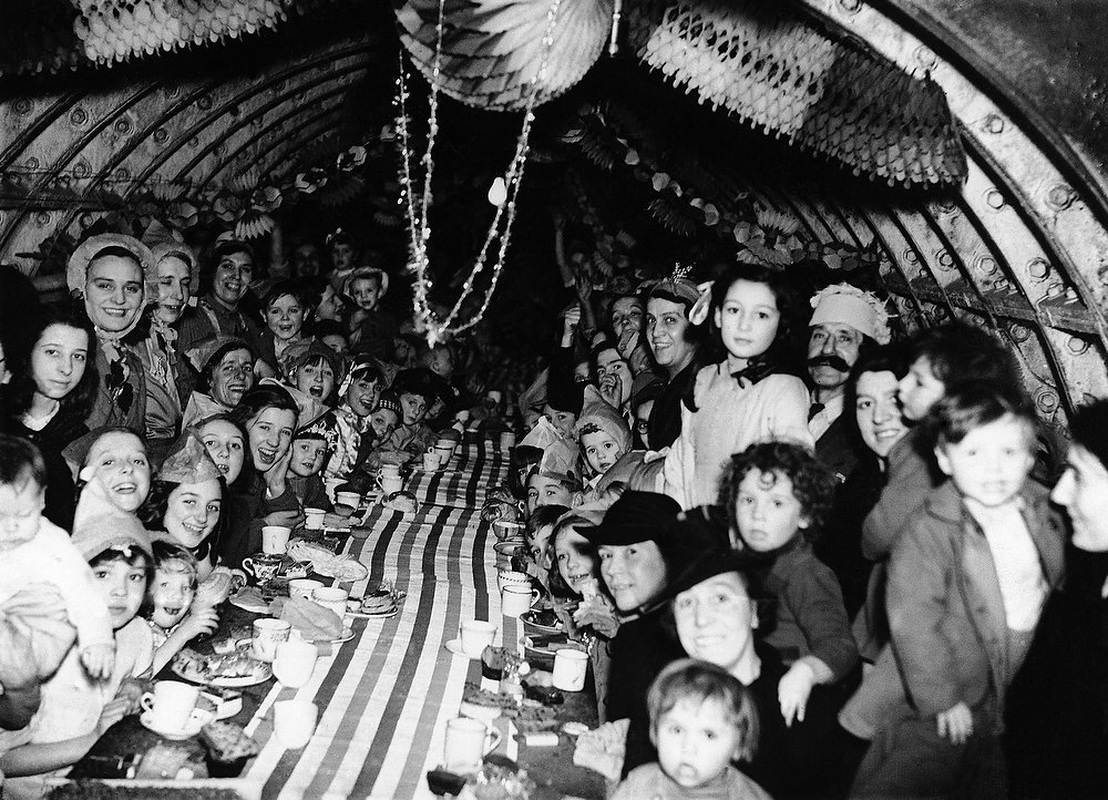 Description of . London children enjoying themselves at a Christmas Party on Dec. 25, 1940 in an underground shelter. (AP Photo)