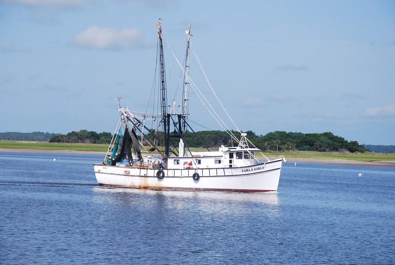 The shrimp boat Earls Girls returning to the harbor in Fernandina Beach, FL