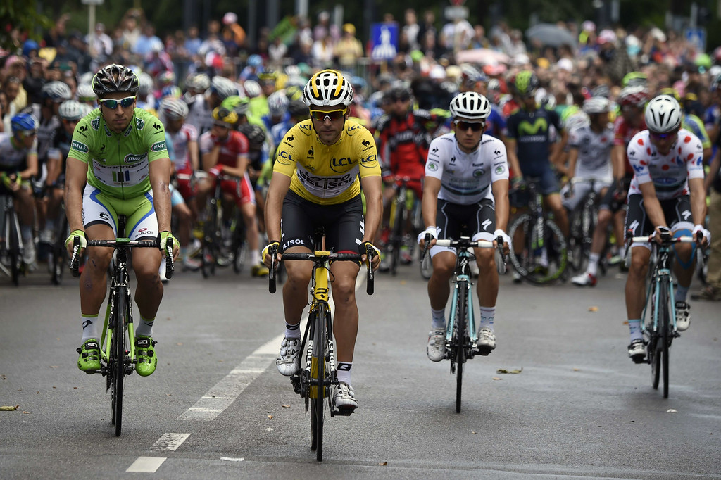 . (From L) Slovakia\'s Peter Sagan wearing the best sprinter\'s green jersey, France\'s Tony Gallopin wearing the overall leader\'s yellow jersey, Poland\'s Michal Kwiatkowski wearing the best young\'s white jersey and Germany\'s Tony Martin wearing the best climber\'s polka dot jersey take the start of the 161.50 km tenth stage of the 101st edition of the Tour de France cycling race on July 14, 2014 between Mulhouse and La Planche des Belles Filles ski resort, eastern France.  AFP PHOTO / ERIC  FEFERBERG/AFP/Getty Images