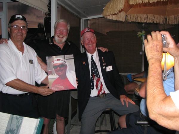 Dick Homovick and Tom Belton presenting Bill Gurnnick with his portrait.jpg