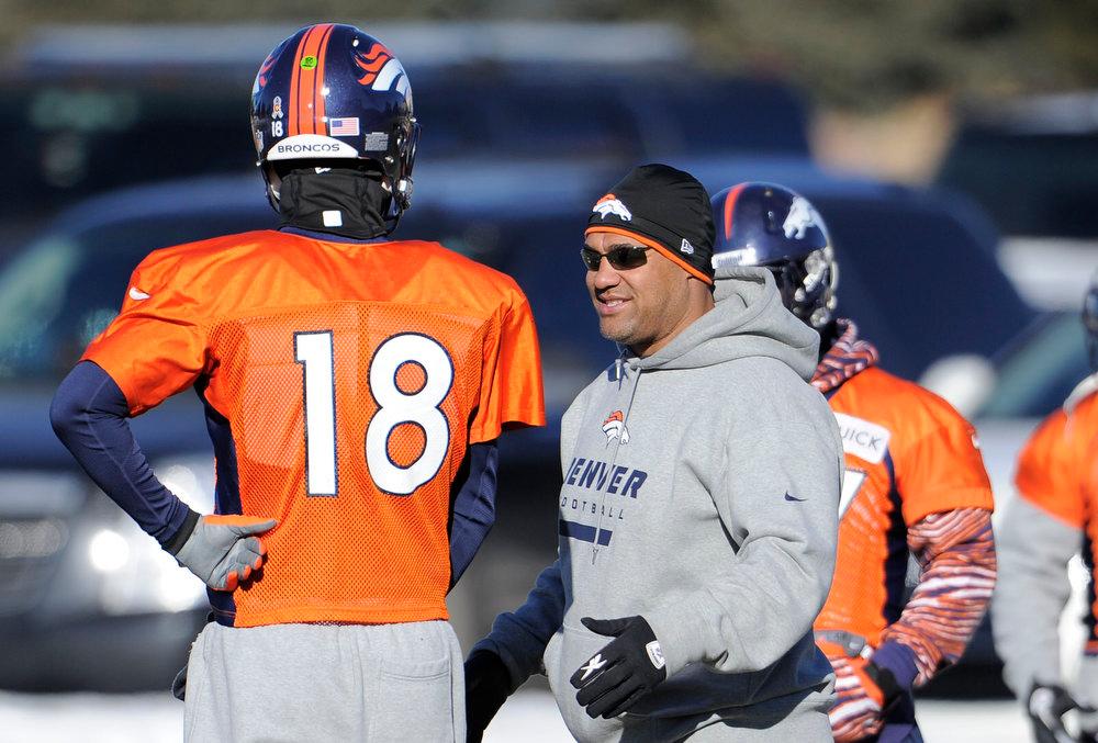 . Denver Broncos quarterback Peyton Manning (18) talks with Eric Studesvilleduring practice Thursday, January 3, 2013 at Dove Valley.  John Leyba, The Denver Post