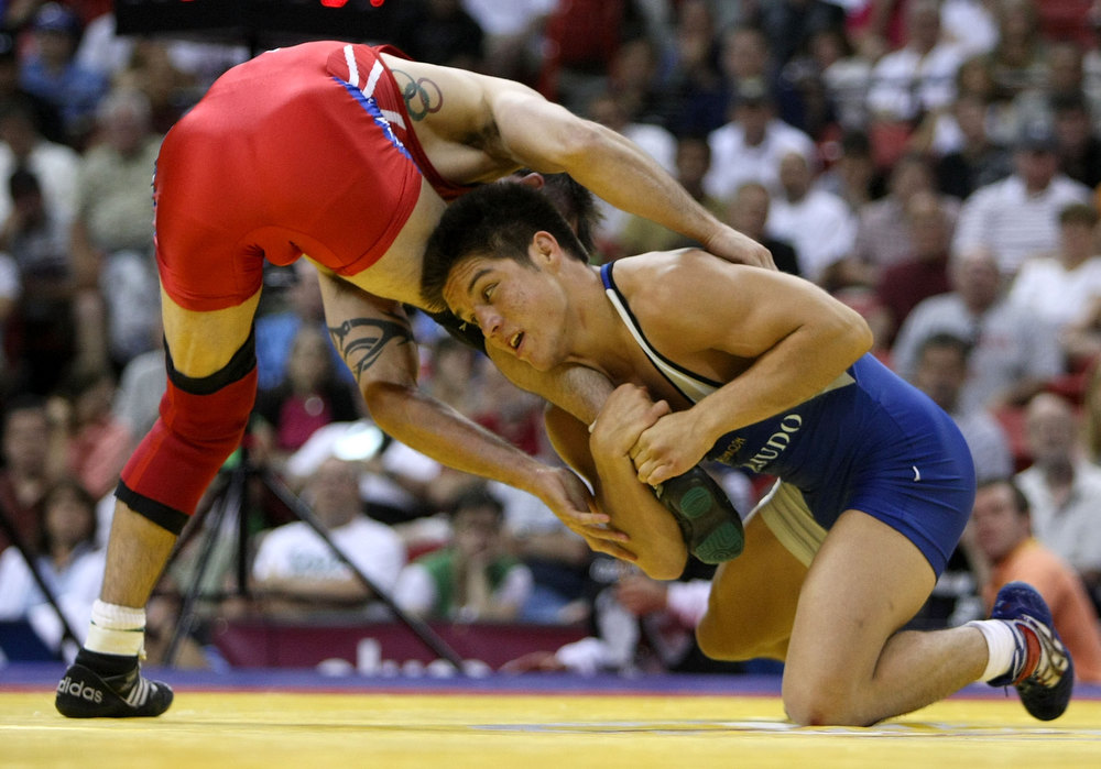 Description of . Henry Cejudo (blue) wrestles Stephan Abas (red) in the Freestyle 55kg division championship match during the USA Olympic trials for wrestling and judo on June 14, 2008 at the Thomas & Mack Center in Las Vegas, Neveda.  (Photo by Jonathan Ferrey/Getty Images)