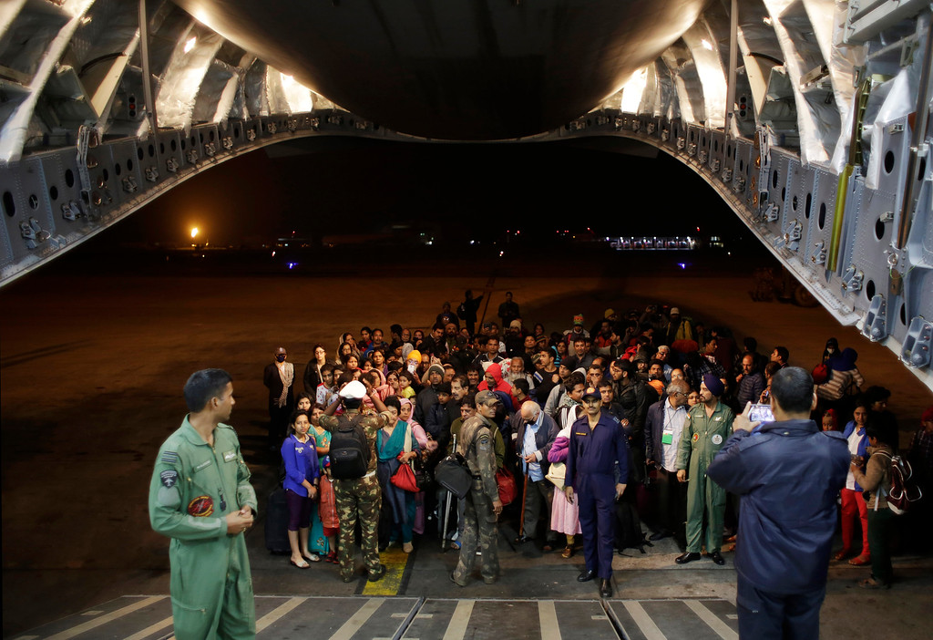 . Survivors of Saturday\'s earthquake wait to board a military plane evacuating injured and stranded Indians from Kathmandu to New Delhi during a midnight rescue mission by Indian Air Force, in Kathmandu, Nepal, Wednesday, April 29, 2015. (AP Photo/Altaf Qadri)