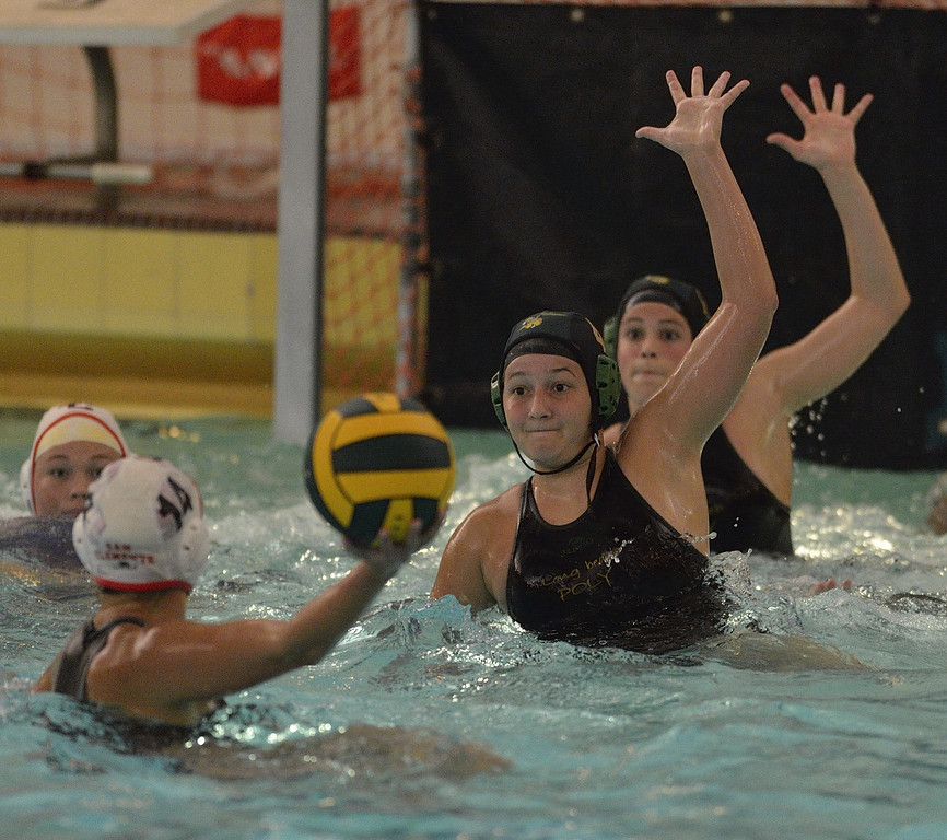 . LONG BEACH, CALIF. USA -- Poly\'s Shannon Johnson (4) and Savannah Steffen (15) try to block a shot from San Clemente\'s Rachel Brownell (11) during their CIF-SS first round game in Long Beach, Calif. on February 12, 2013. Poly lost to San Clemente, 7 to 6. Photo by Jeff Gritchen / Los Angeles Newspaper Group