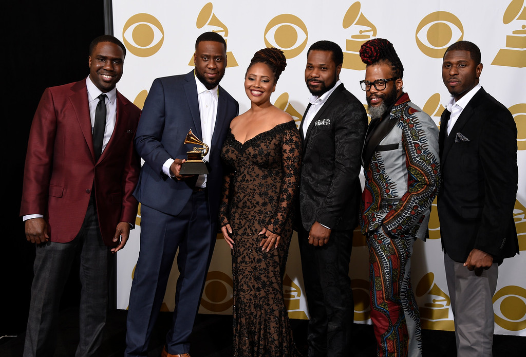 . Derrick Hodge, from left, Robert Glasper, Lalah Hathaway, Malcolm-Jamal Warner, Casey Benjamin and Mark Colenburg pose in the press room with the award for best traditional R&B performance for �Jesus Children� at the 57th annual Grammy Awards at the Staples Center on Sunday, Feb. 8, 2015, in Los Angeles. (Photo by Chris Pizzello/Invision/AP)