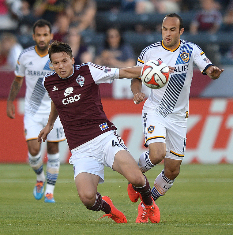 . COMMERCE CITY, CO - MAY 3:  Colorado defender Marc Burch (4) tried to slow down Los Angeles midfielder Landon Donovan (10) in the first half. The Colorado Rapids defeated the Los Angeles Galaxy 1-0 Saturday night, May 3, 2014 at Dick\'s Sporting Good Park. (Photo by Karl Gehring/The Denver Post)