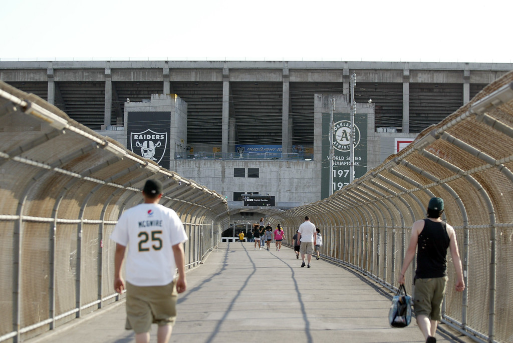 . Fans walk on the BART-Coliseum corridor as the Oakland Athletics will take on the Chicago Cubs on their first appearance at O.co Coliseum in Oakland, Calif., on Tuesday, July 2, 2013.  (Ray Chavez/Bay Area News Group)