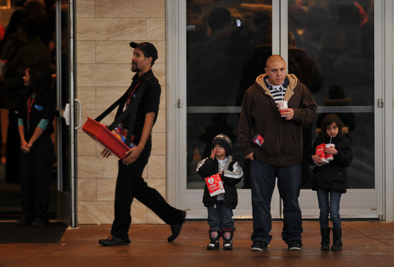 . AURORA, CO - JANUARY 17: People have free popcorn and soda in front of the Century Aurora. The movie theater where a gunman killed 12 people and wounded dozens of others reopened with a private ceremony for victims, first responders and officials. (Photo By Hyoung Chang / The Denver Post)