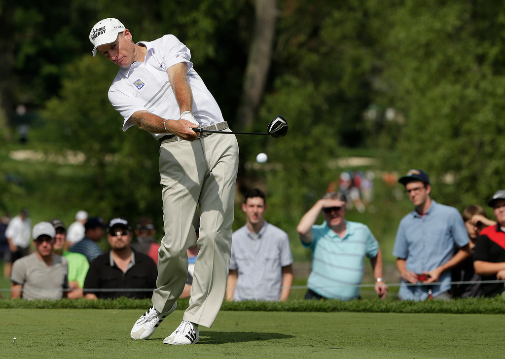 . Jim Furyk hits his tee shot on the ninth hole during the second round of the PGA Championship golf tournament at Oak Hill Country Club, Friday, Aug. 9, 2013, in Pittsford, N.Y. (AP Photo/Charlie Riedel)