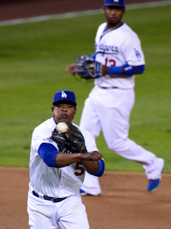 . The Dodgers\' Juan Uribe throws to first base during game 3 against the St. Louis Cardinals in the NLCS at Dodger Stadium Monday, October 14, 2013. The Dodgers beat the Cardinals 3-0. (Photo by Sarah Reingewirtz/Los Angeles Daily News)