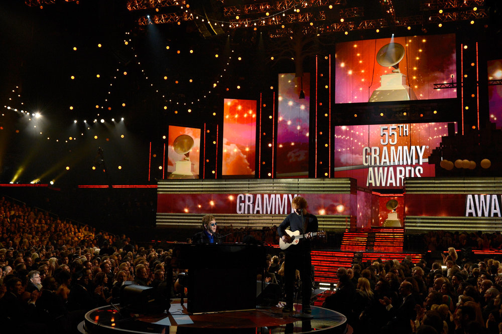 . Musicians Elton John (L) and Ed Sheeran perform onstage at the 55th Annual GRAMMY Awards at Staples Center on February 10, 2013 in Los Angeles, California.  (Photo by Kevork Djansezian/Getty Images)