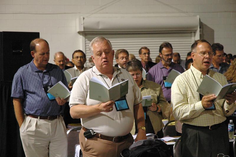 Voting members singing