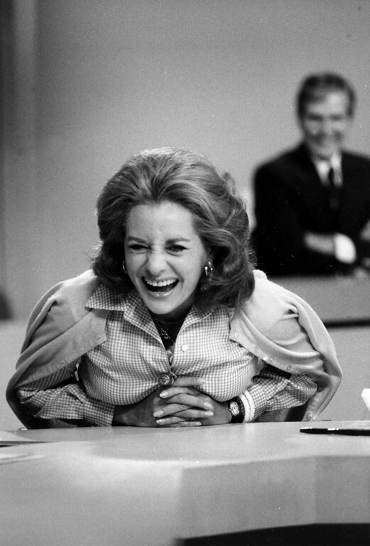 . Television newswoman Barbara Walters, co-host of NBC\'s Today Show, shares a laugh with staff members in New York City, June 3, 1976. Today will be Walters\' last live appearance on NBC as she joins ABC to become the rival networks\' evening news anchorwoman.  (AP Photo)