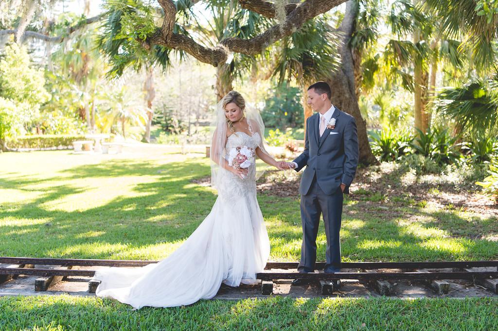 bride and groom on tracks