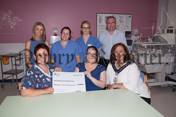 Newry, Mourne and Down DC members raised £1600 for the Special Baby Care Unit at Daisy Hill. Pictured with nurses Charlotte Harriss, Emma Bridges and Jane Lynch are Gillian Fitzpatrick, Lorraine Halpin, Kerri Morrow and Keviv Devlin. R1634023