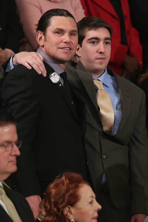. WASHINGTON, DC - JANUARY 28:  Carlos Arredondo (L) and Jeff Bauman who was injured during the Boston bombing watch as U.S. President Barack Obama delivesr the State of the Union address to a joint session of Congress in the House Chamber at the U.S. Capitol on January 28, 2014 in Washington, DC. In his fifth State of the Union address, Obama is expected to emphasize on healthcare, economic fairness and new initiatives designed to stimulate the U.S. economy with bipartisan cooperation.  (Photo by Chip Somodevilla/Getty Images)