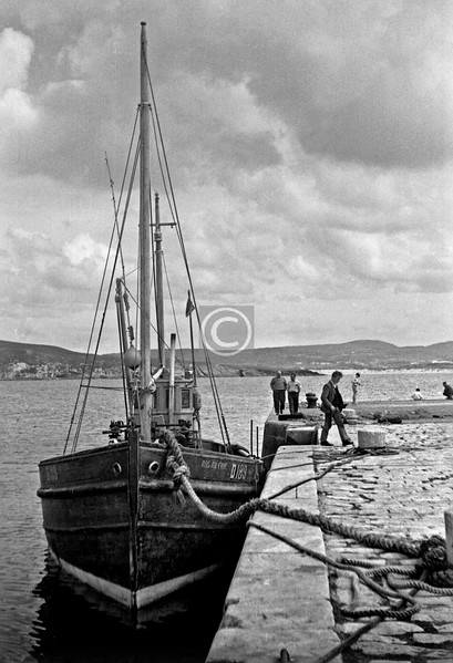 Ros na Cille D189, at Downings. This trawler, built here in 1956, is preserved at Greencastle Maritime Museum.  ps I've only just realised that the two men walking together are my father George McCallum (on the right) and his pal Willie Wasson who was a native of this part of Ireland.